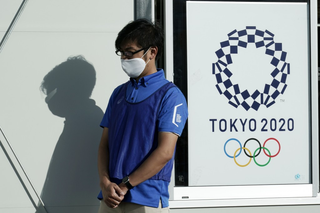A staff member participates in a screening test for spectators and officials to ensure a safe and secure Toyo Olympic Games Wednesday, Oct. 21, 2020, ...