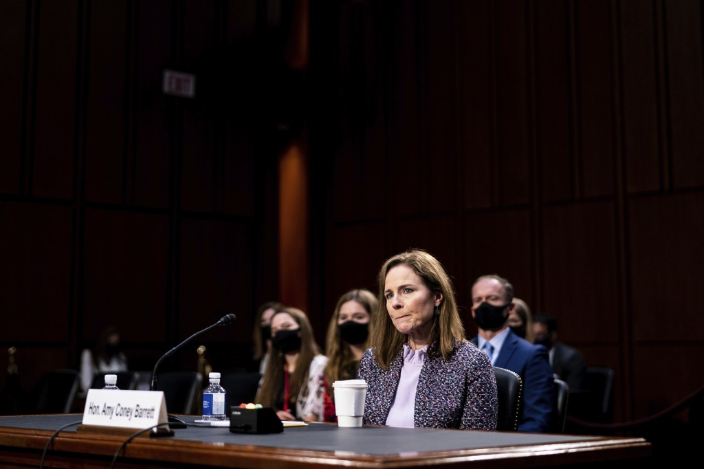FILE - In this Oct. 14, 2020, file photo, Supreme Court nominee Amy Coney Barrett listens during a confirmation hearing before the Senate Judiciary Co...