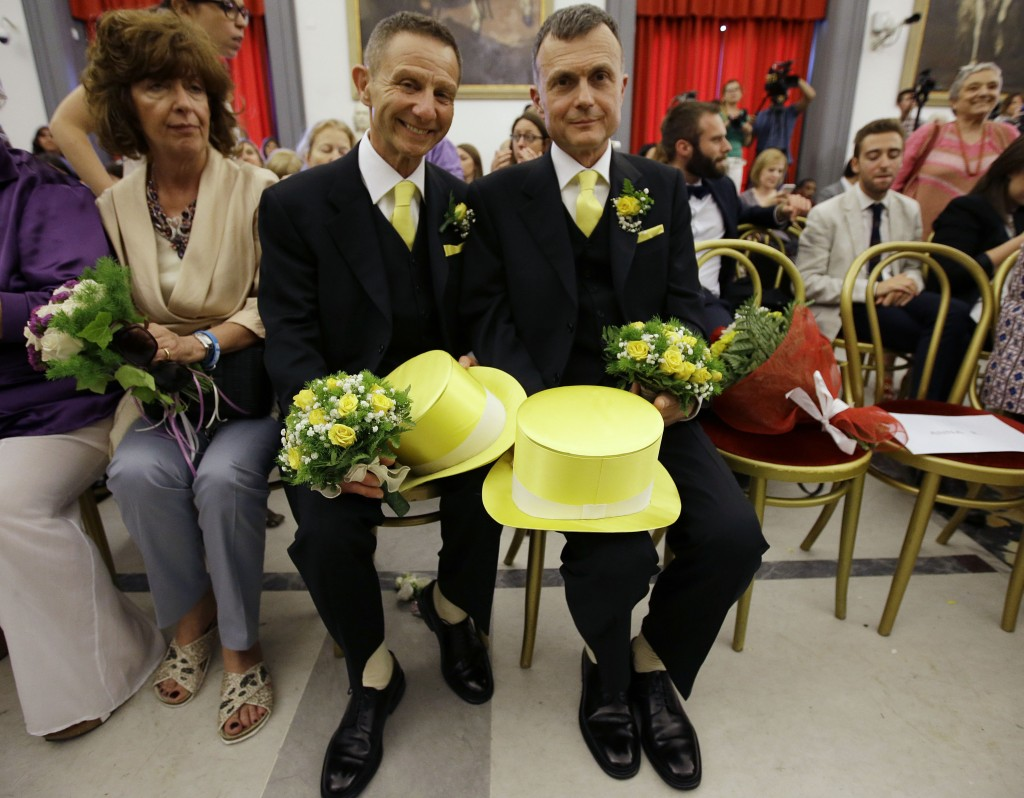 FILE - In this May 21, 2015 file photo, Angelo Albanesi, left, and Pier Giorgio De Simone wait for their civil union to be registered by a municipalit...