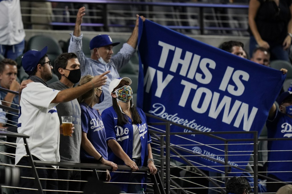 Los Angeles Dodgers fans watch during the seventh inning in Game 1 of the baseball World Series against the Tampa Bay Rays Tuesday, Oct. 20, 2020, in ...