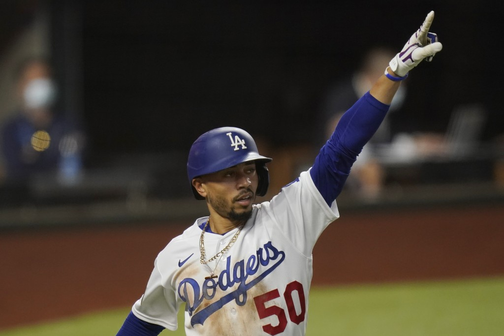 Los Angeles Dodgers' Mookie Betts celebrates a home run against the Tampa Bay Rays during the sixth inning in Game 1 of the baseball World Series Tues...