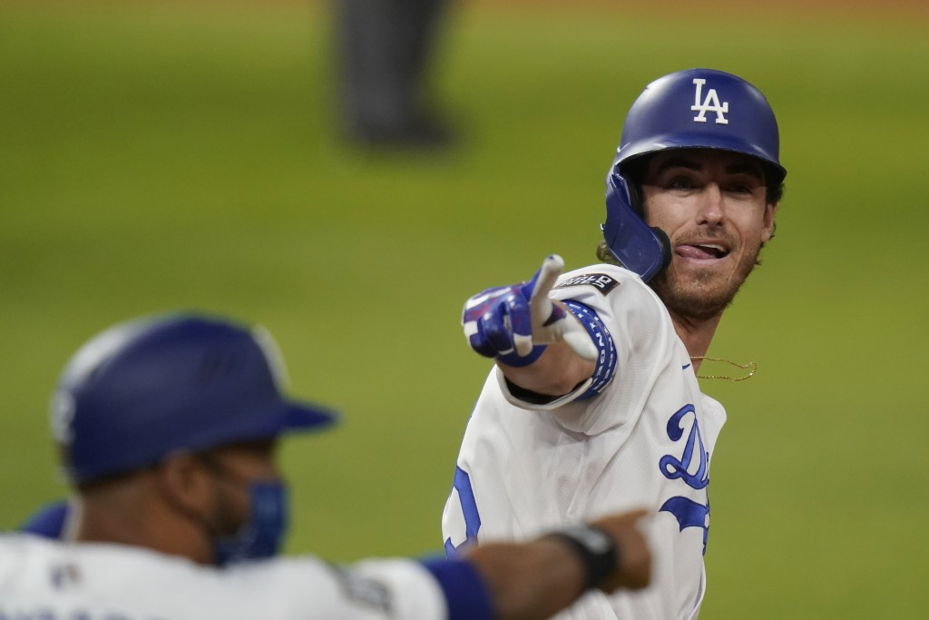 Los Angeles Dodgers' Cody Bellinger celebrates his two-run home run against the Tampa Bay Rays during the fourth inning in Game 1 of the baseball Worl...