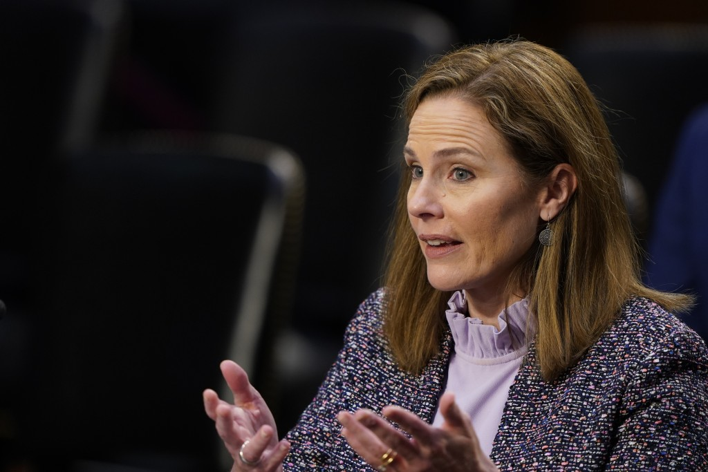 In this Oct. 14, 2020, photo, Supreme Court nominee Amy Coney Barrett speaks during a confirmation hearing before the Senate Judiciary Committee on Ca...