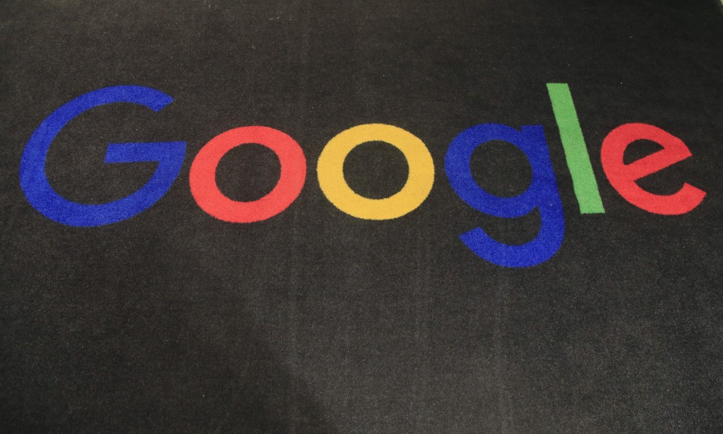 FILE - In this Monday, Nov. 18, 2019, file photo, the logo of Google is displayed on a carpet at the entrance hall of Google France in Paris. The Trum...