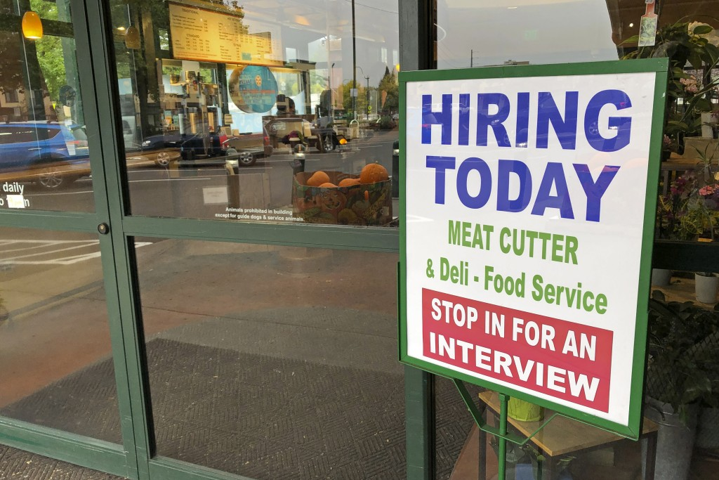 """A sign that reads """"hiring today,"""" is shown at a grocery store in Olympia, Wash., advertising a job opportunity for a meat cutter on Oct. 3, 2020.   On..."""