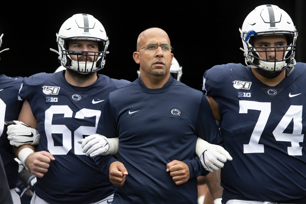 FILE - In this Saturday, Sept. 14, 2019 file photo, Penn State head coach James Franklin leads his team onto the field for an NCAA college football ga...