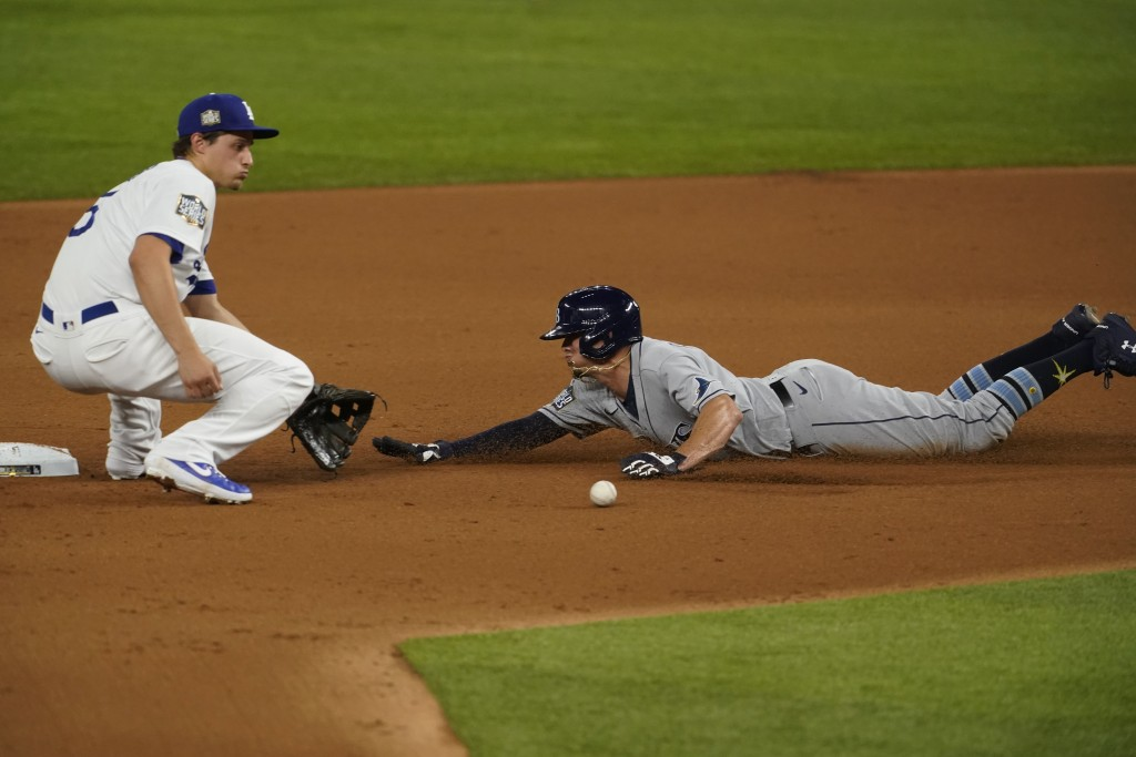 Tampa Bay Rays' Willy Adames is tagged out at second stealing by Los Angeles Dodgers shortstop Corey Seager during the second inning in Game 2 of the ...
