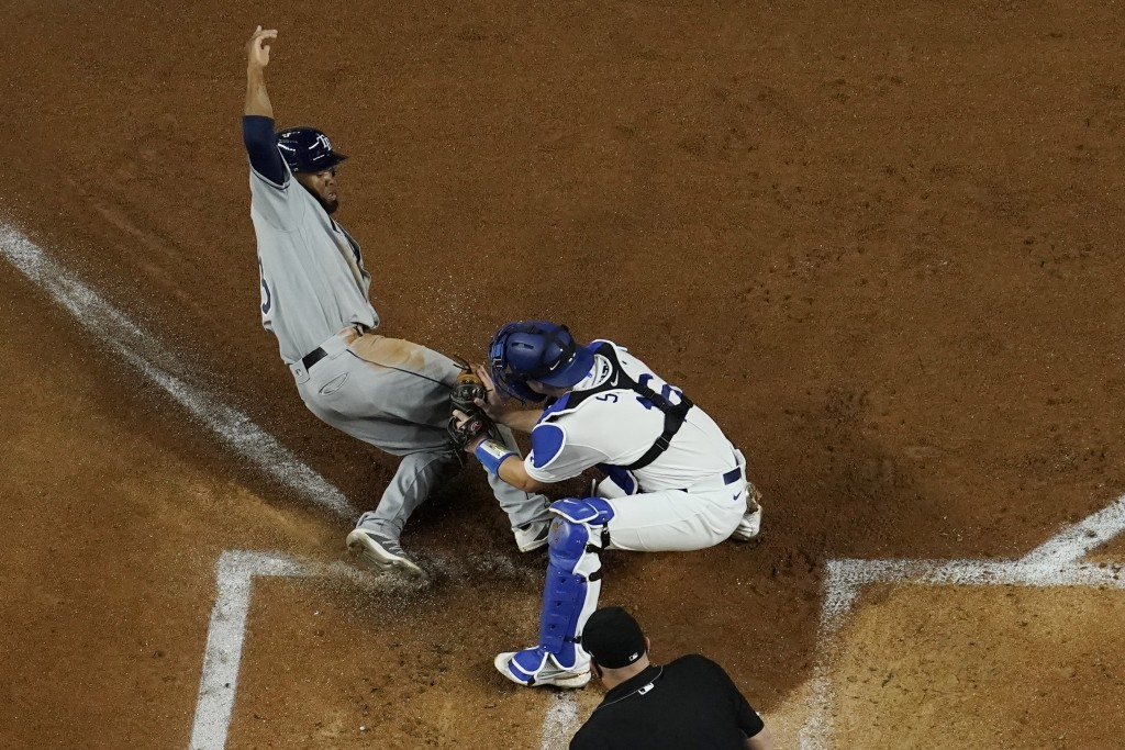 Los Angeles Dodgers catcher Will Smith tags out Tampa Bay Rays' Manuel Margot at home during the second inning in Game 2 of the baseball World Series ...
