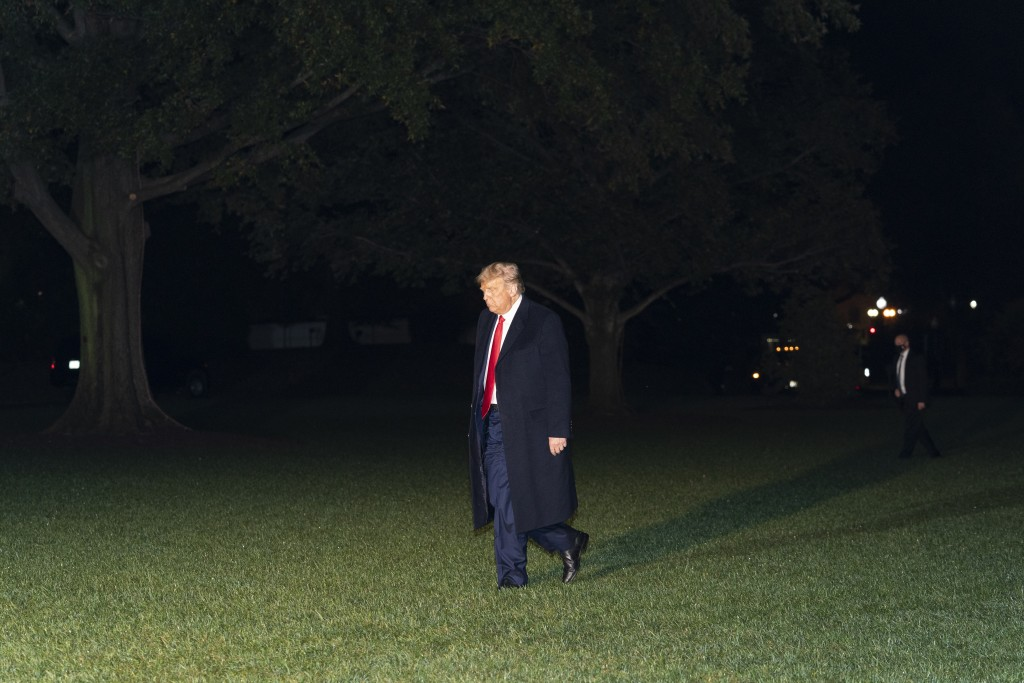 President Donald Trump walks on the South Lawn of the White House after stepping off Marine One, Wednesday, Oct. 21, 2020, in Washington. Trump is ret...