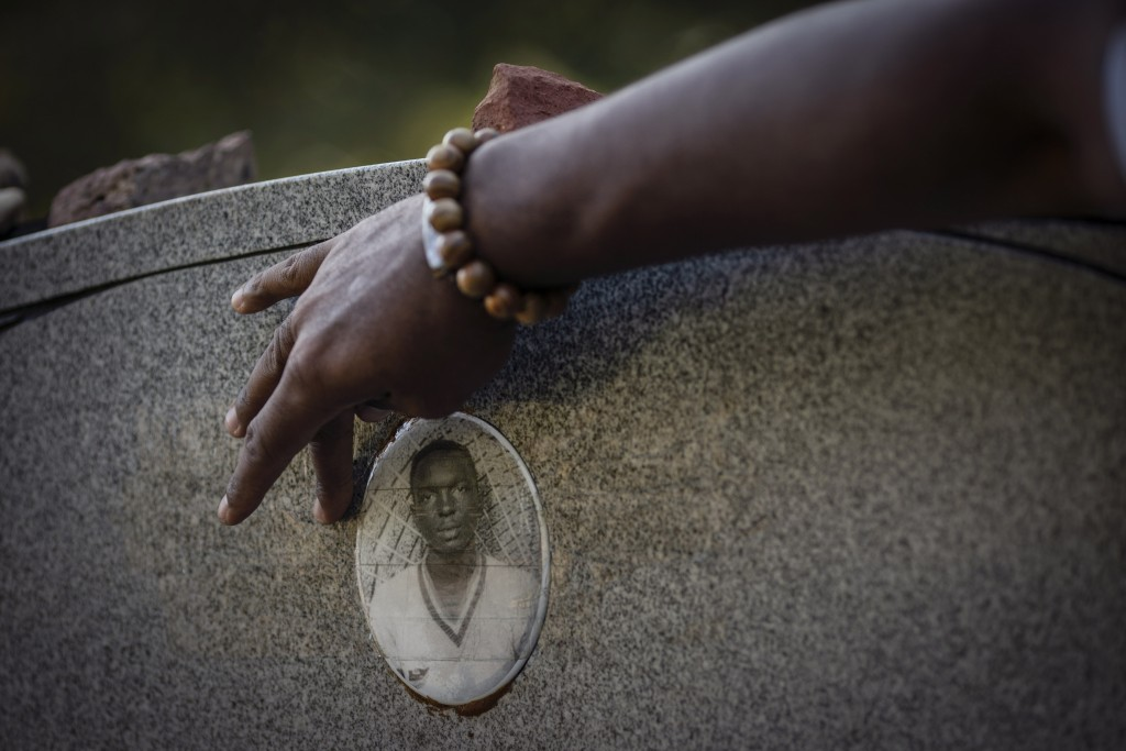 A portrait of James Chaney is seen on the headstone of his grave in Meridian, Miss., Saturday, Oct. 3, 2020. Chaney was one of three civil rights acti...