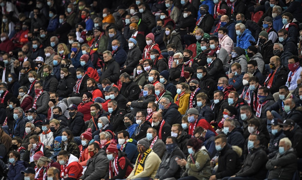 Soccer fans wear face masks during the Champions League group A soccer match between RB Salzburg and Lokomotiv Moscow in Salzburg, Austria, Wednesday,...