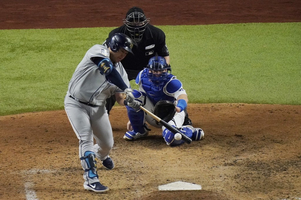 Tampa Bay Rays' Ji-Man Choi singles against the Los Angeles Dodgers during the sixth inning in Game 2 of the baseball World Series Wednesday, Oct. 21,...