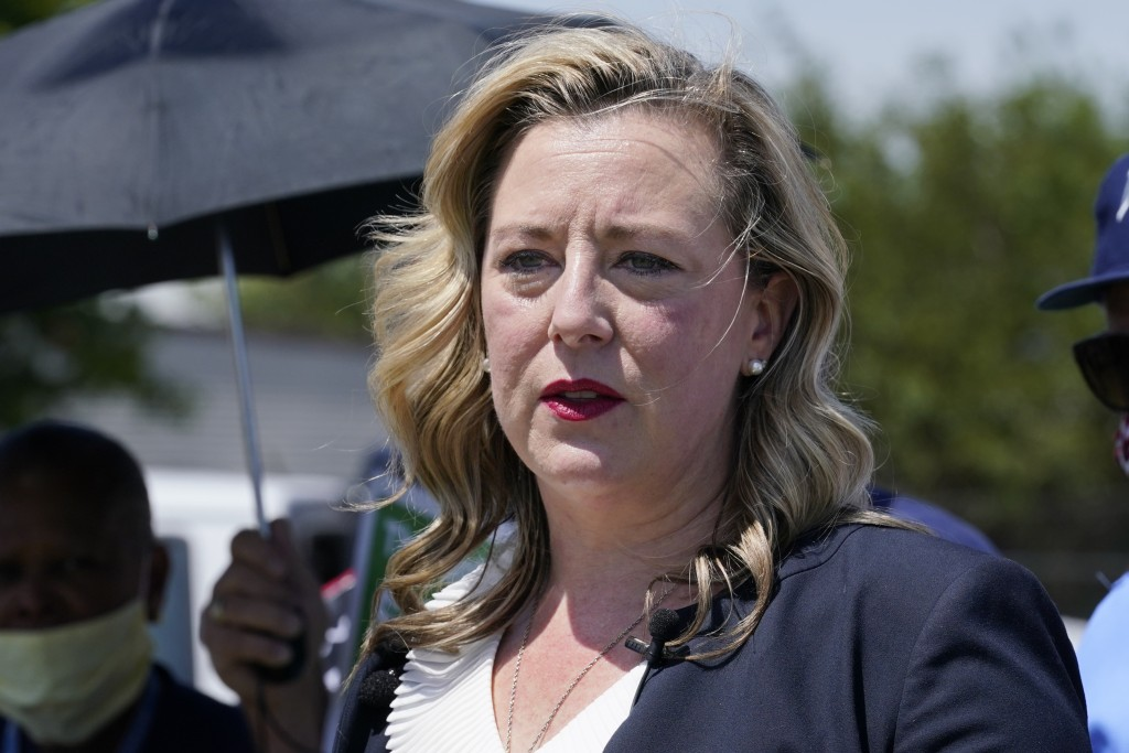 FILE - In this Tuesday, Aug. 18, 2020, file photo, U.S. Rep. Kendra Horn, D-Okla., speaks during a news conference in front of a post office in Oklaho...