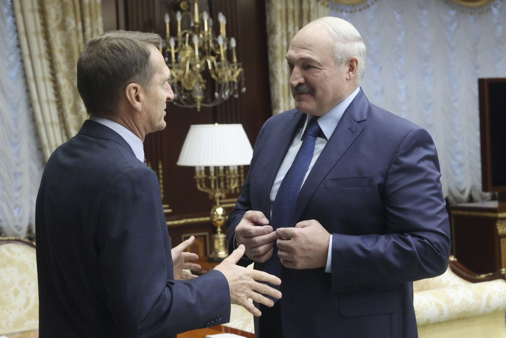 Belarusian President Alexander Lukashenko, right, talks with Sergei Naryshkin, head of the Russian Foreign Intelligence Service, during their meeting ...
