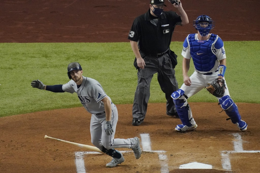 Tampa Bay Rays' Brandon Lowe watches his home run against the Los Angeles Dodgers during the first inning in Game 2 of the baseball World Series Wedne...