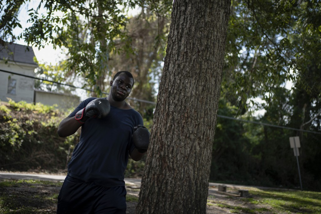 Davonta Oliver, 18, exercises by boxing outside his home in Meridian, Miss., Wednesday, Oct. 7, 2020. Oliver, who decided not to vote, says that he be...