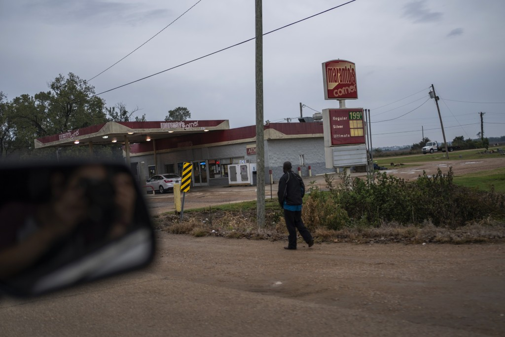 A man walks past a gas station in Anguilla, Miss., Friday, Oct. 9, 2020. Today, voters in Mississippi face a series of government-created barriers tha...