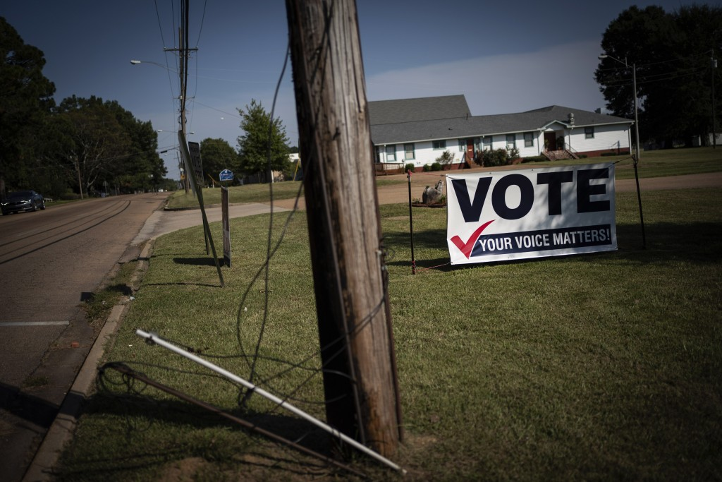 A banner urging citizens to vote is displayed on the side of a street in Jackson Miss., Sunday, Oct. 4, 2020. The opposition to Black votes in Mississ...