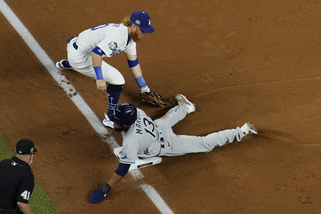 Tampa Bay Rays' Manuel Margot is safe at third past Los Angeles Dodgers third baseman Justin Turner on a ball hit by Joey Wendle during the second inn...