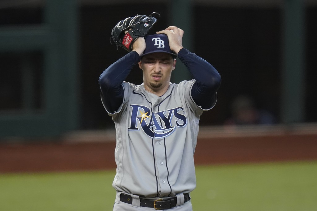 Tampa Bay Rays starting pitcher Blake Snell reacts after giving up two-run home run to Los Angeles Dodgers' Chris Taylor during the fifth inning in Ga...