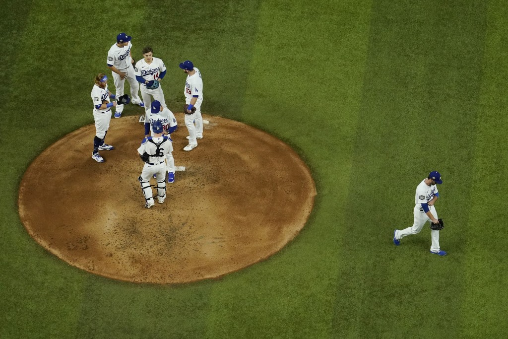 Los Angeles Dodgers relief pitcher Dylan Floro leaves the game against the Tampa Bay Rays during the third inning in Game 2 of the baseball World Seri...