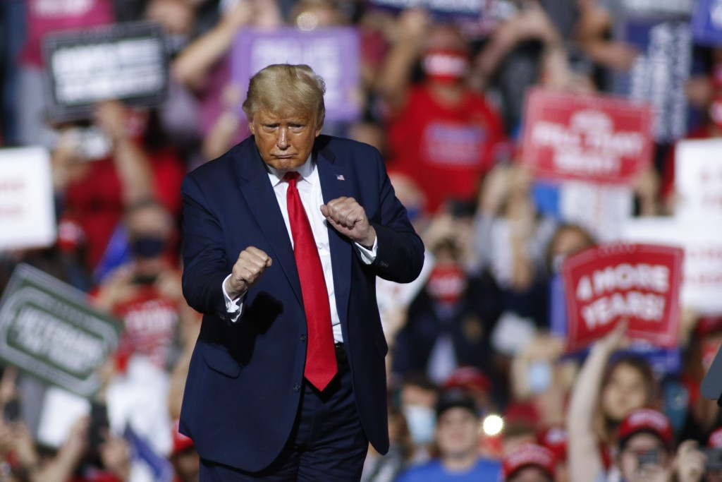 President Donald Trump dances after speaking at a campaign rally in Gastonia, N.C., Wednesday, Oct. 21, 2020. (AP Photo/Nell Redmond)