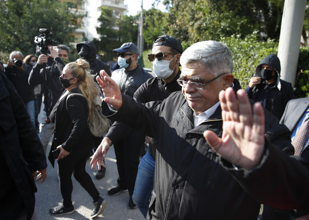 Golden Dawn party leader Nikos Michaloliakos waves as he leaves his residence in Athens, Thursday, Oct. 22, 2020.A court has sentenced Michaloliakos a...
