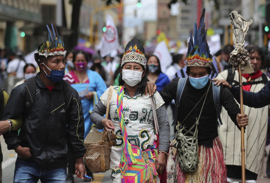 A group of Indigenous march during a national strike in Bogota, Colombia, Wednesday, Oct. 21, 2020. Workers' unions, university students, human rights...