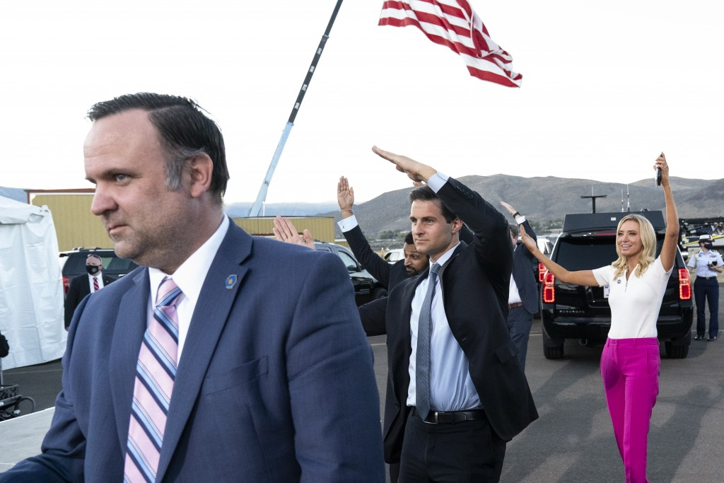 In this Oct. 18. 2020 photo, White House social media director Dan Scavino, left, Director of the White House Presidential Personnel Office John McEnt...