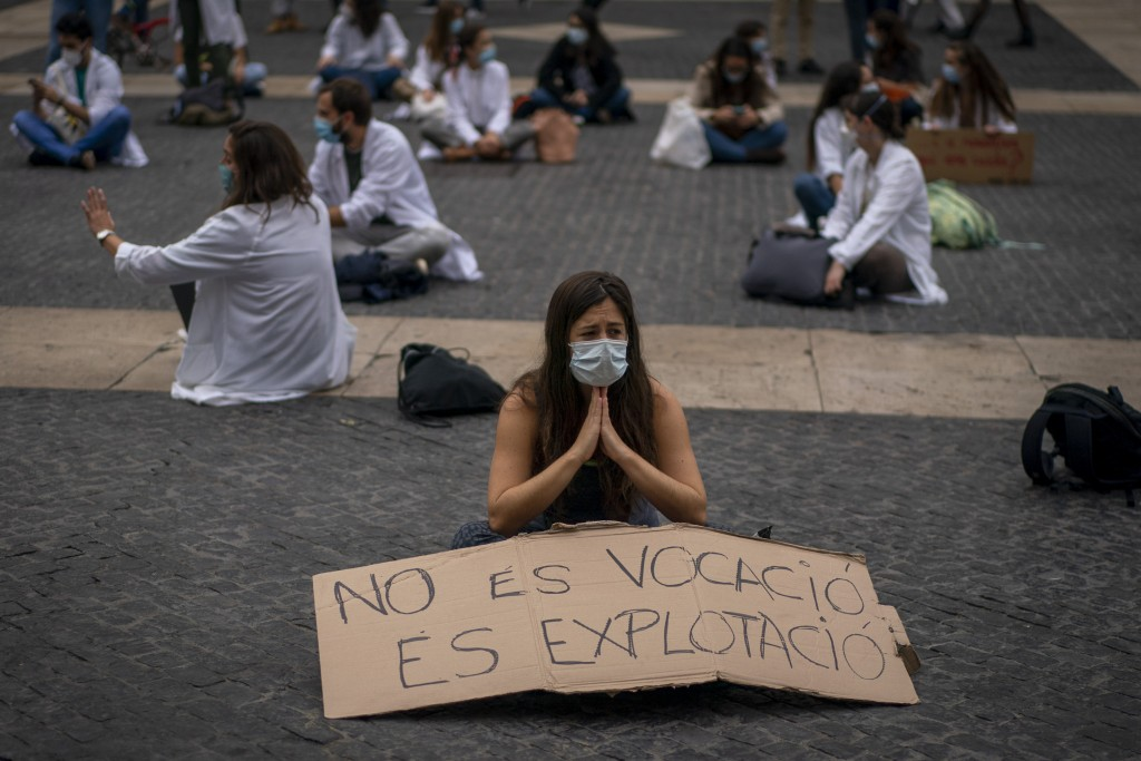 Medical residents take part on a protest against their working conditions during a strike in Barcelona, Spain, Thursday, Oct. 22, 2020. Spain has repo...