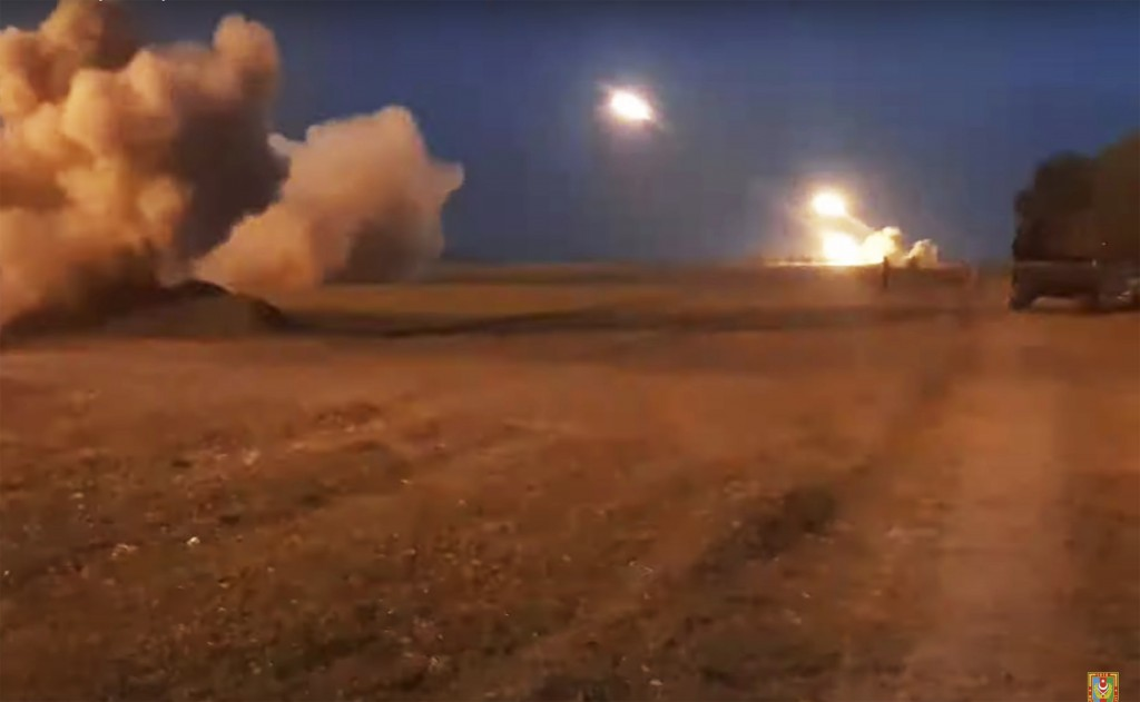 In this image taken from video released by Azerbaijan's Defense Ministry on Wednesday, Oct. 21, 2020, Azerbaijan's army artillery fire during fighting...