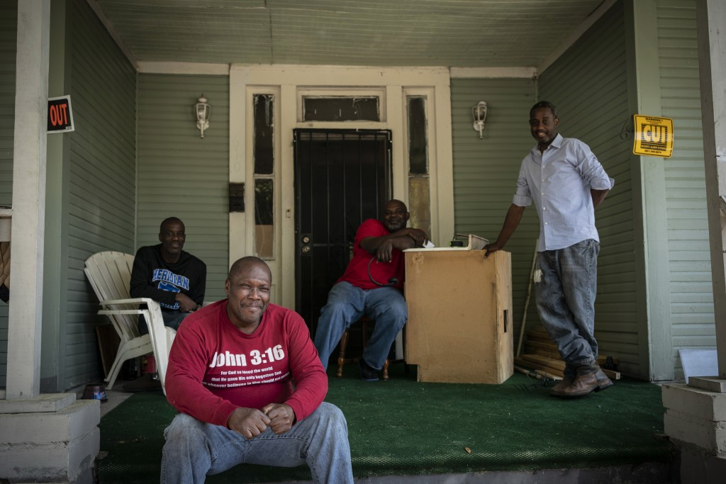 Pictured from left to right, Gregory Blanchard, 53, Clyde Lewis, 59, Tommy McCoy, 48 and Anthony Boggan, 49, pose for a group portrait on McCoy's fron...