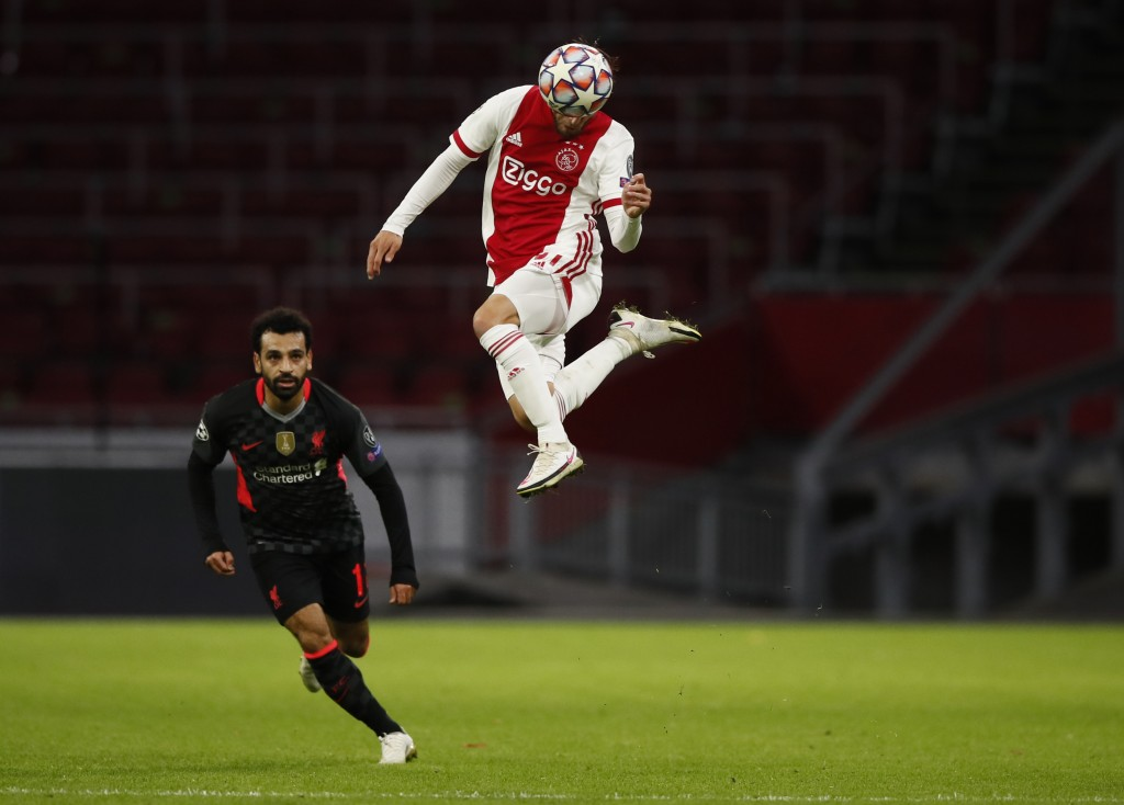 Ajax's Nicolas Tagliafico controls the ball as Liverpool's Mohamed Salah, left, looks on, during the group D Champions League soccer match between Aja...