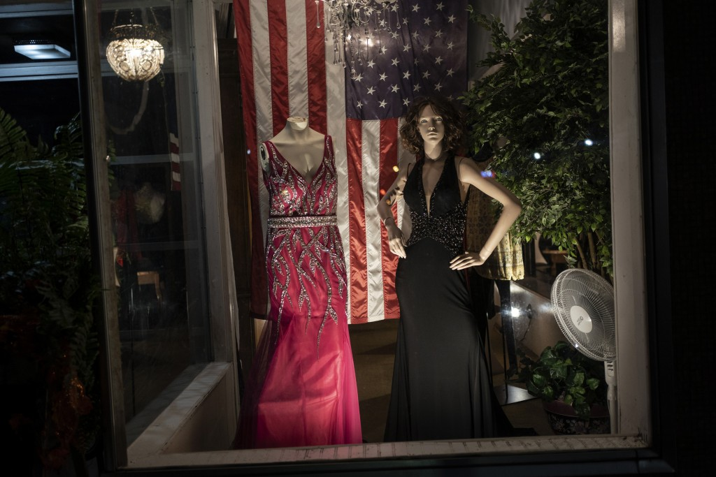 Mannequins are illuminated in a shop window in Philadelphia, Miss., Sunday, Oct. 4, 2020. Today, voters in Mississippi face a series of government-cre...
