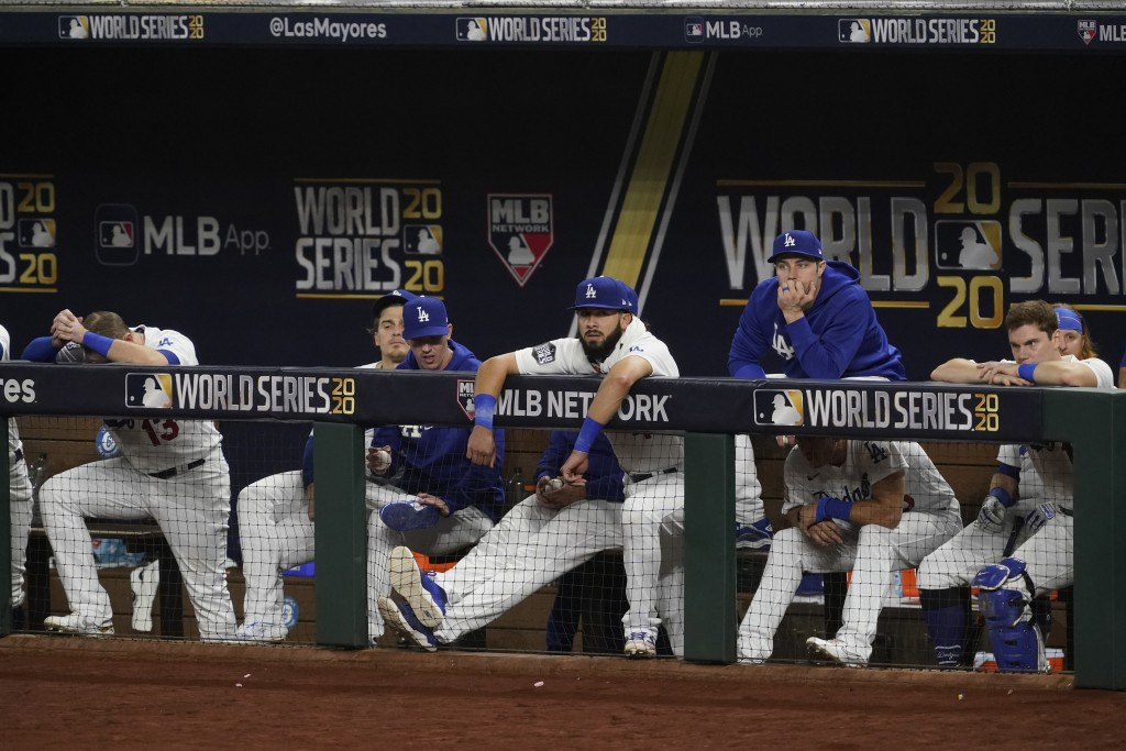 Members of the Los Angeles Dodgers watch during the seventh inning in Game 2 of the baseball World Series against the Tampa Bay Rays Wednesday, Oct. 2...