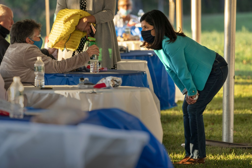 """Sara Gideon, right, a Democratic candidate for U.S. Senate, speaks with an attendee at a """"Supper with Sara"""" campaign event, Thursday, Oct. 1, 2020, in..."""