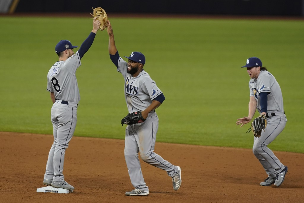 The Tampa Bay Rays celebrates their win against the Los Angeles Dodgers in Game 2 of the baseball World Series Wednesday, Oct. 21, 2020, in Arlington,...