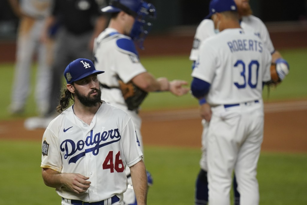 Los Angeles Dodgers starting pitcher Tony Gonsolin leaves the game against the Tampa Bay Rays during the second inning in Game 2 of the baseball World...