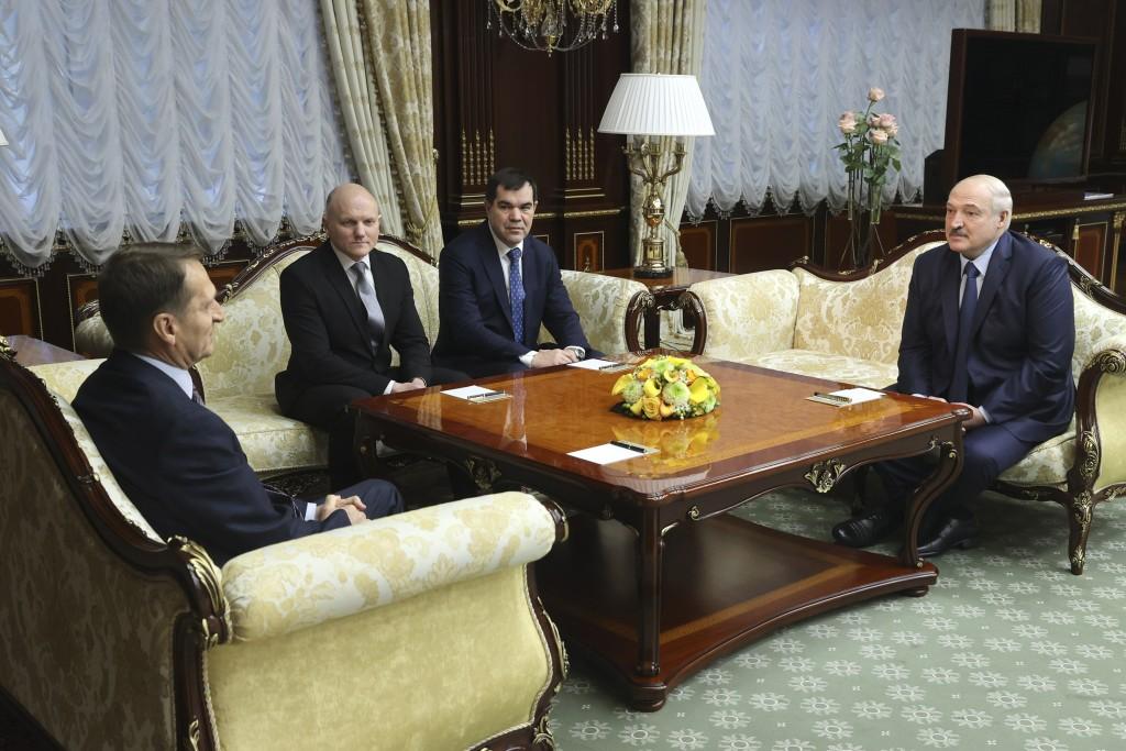 Sergei Naryshkin, head of the Russian Foreign Intelligence Service, left, speaks to Belarusian President Alexander Lukashenko, right, in Minsk, Belaru...
