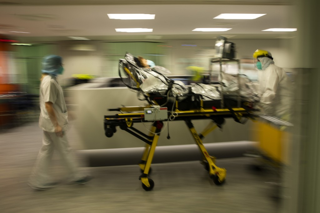 Medical staff transfer a COVID-19 patient, due to the lack of room, from the CHR Citadelle hospital in Liege, Belgium, Wednesday, Oct. 21, 2020. Autho...