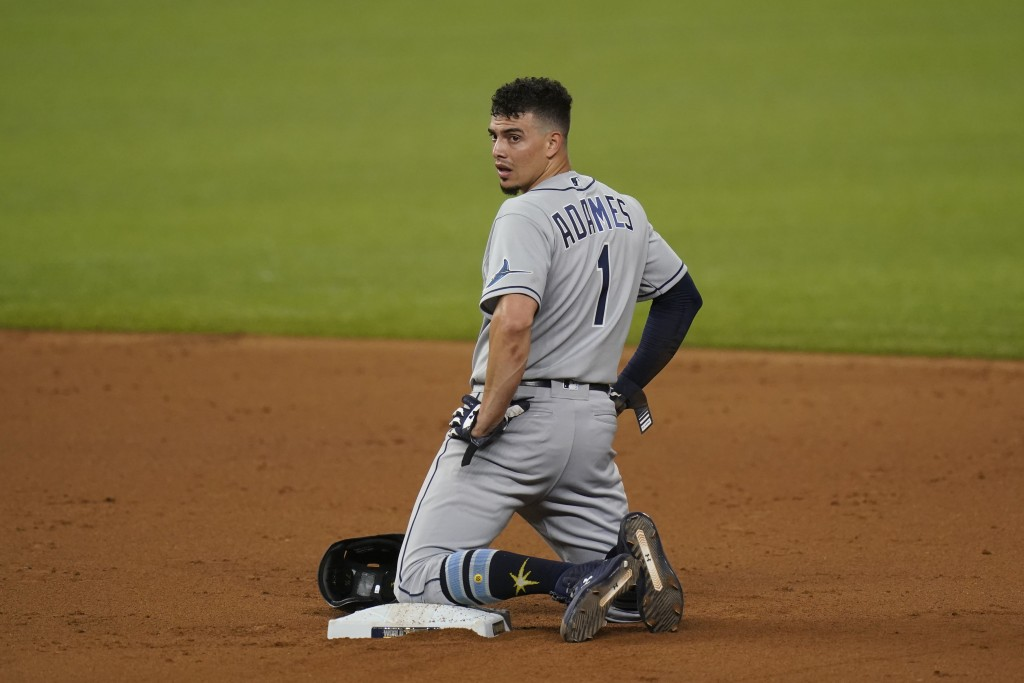Tampa Bay Rays' Willy Adames reacts after getting tagged out stealing against the Los Angeles Dodgers during the second inning in Game 2 of the baseba...