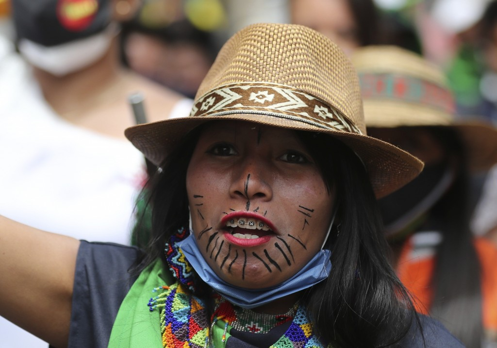 An Indigenous woman marches during a national strike in Bogota, Colombia, Wednesday, Oct. 21, 2020. Workers' unions, university students, human rights...