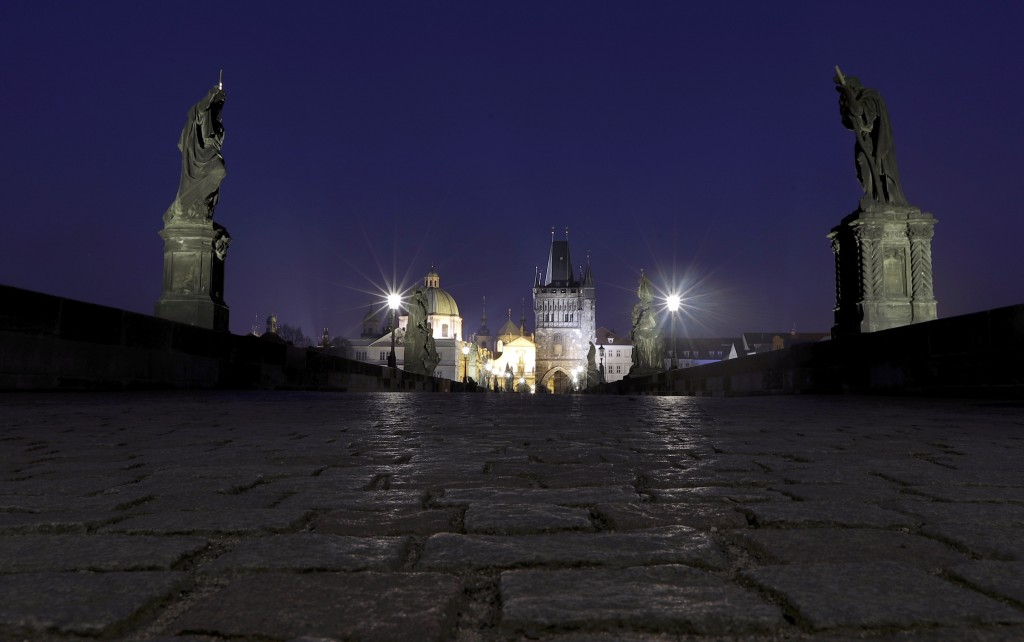 FILE - In this March 28, 2020 file photo a general view of the near empty Charles Bridge in Prague, Czech Republic. (AP Photo/Petr David Josek, File)