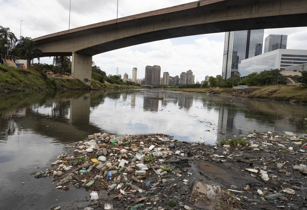 Debris floats in the Pinheiros River in Sao Paulo, Brazil, Thursday, Oct. 22, 2020. Affected by domestic sewage and solid wastes discharges for years,...