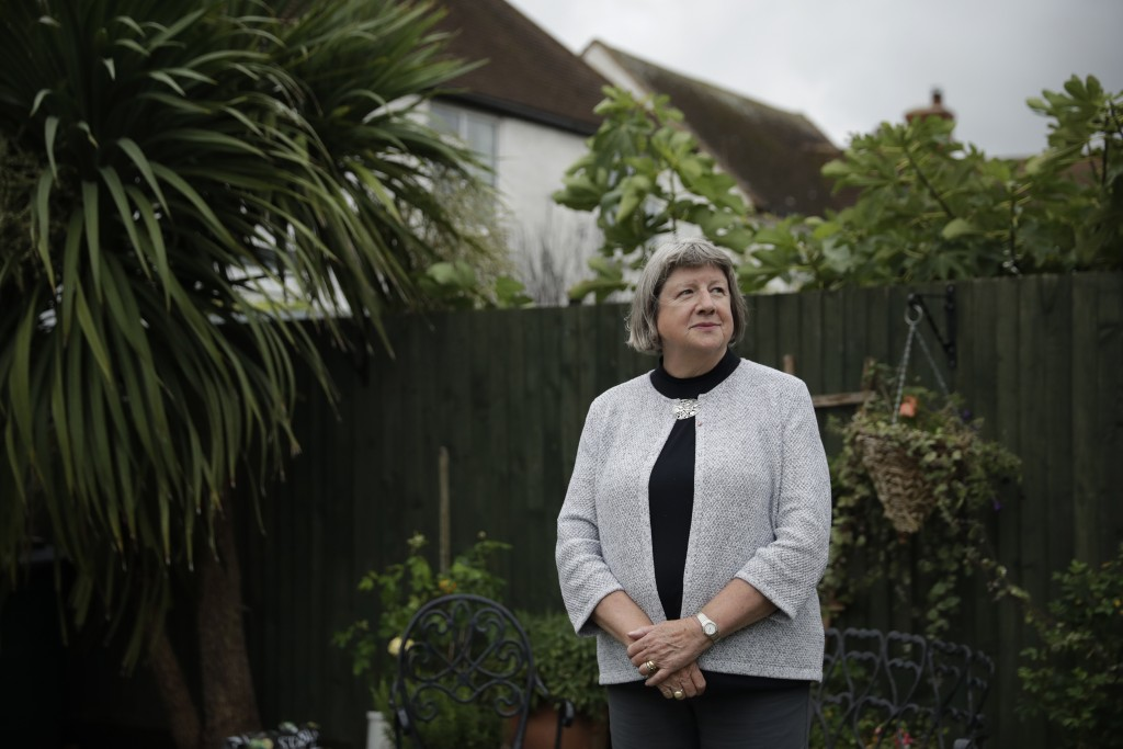 Mayflower descendant Vicky Cosstick poses for a portrait in the back garden of her home in the town of Seaford, on the south coast of England, Friday,...