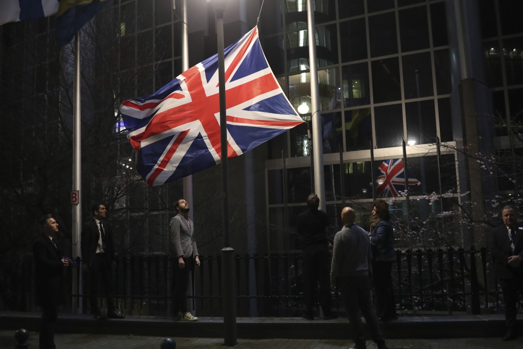 FILE - In this Friday, Jan. 31, 2020 file photo, the Union flag is lowered and removed from outside of the European Parliament in Brussels. It's more ...