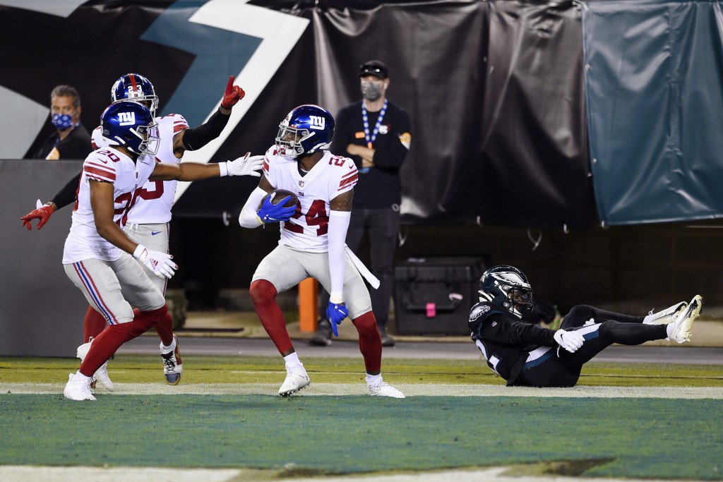 New York Giants' James Bradberry (24) reacts with teammates after intercepting a pass during the first half of an NFL football game against the Philad...