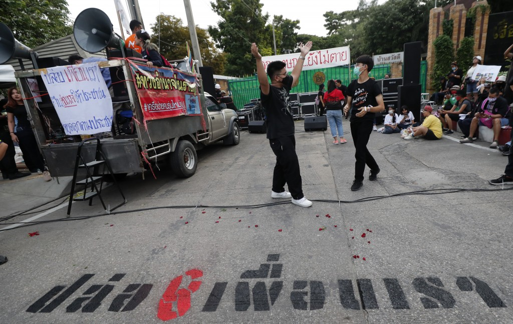 Pro-democracy activists gather outside remand prison, in which some of the activists are kept, in Bangkok, Thailand, Friday, Oct. 23, 2020. Thailand's...