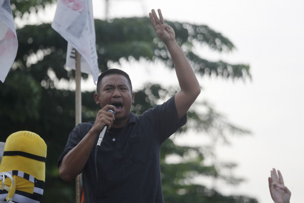 Jatupat Boonpattararaksa, a pro-democracy leader, delivers a speech outside remand prison, in which some of the activists are kept, in Bangkok, Thaila...