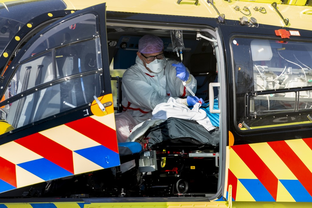 A COVID-19 patient is being tended to prior to being airlifted with the helicopter from FlevoZiekenhuis, or FlevoHospital, in Almere, Netherlands, Fri...